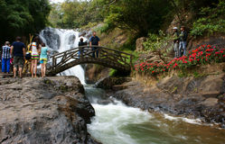 Traveler in ecotourism on vacation at waterfall royalty free stock photography