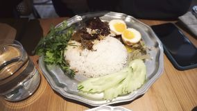 Traveler enjoys Kao Ka Moo - slow-braised pork leg on rice.