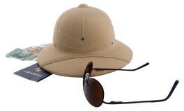 Traveler essentials 1. Pith helmet, passport, retro sunglasses, and foreign money stock images