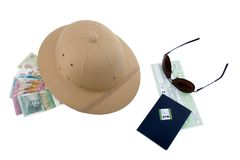 Traveler essentials 3. Pith helmet, passport, retro sunglasses, and foreign money, and train ticket Royalty Free Stock Photos