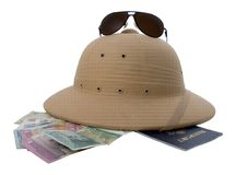 Traveler essentials 6. Pith helmet, passport, retro sunglasses, and foreign money stock image