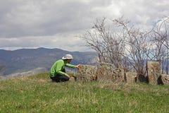 Traveler explores the ancient cross-stones in Armenia Royalty Free Stock Photography