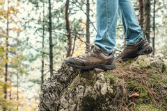 Traveler feet in outdoor shoes Royalty Free Stock Image