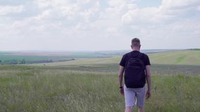 The traveler is on the field. Summer day stock video footage