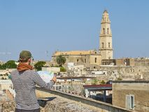 Traveler in front of Lecce rooftop view. Puglia, southern Italy. Royalty Free Stock Image