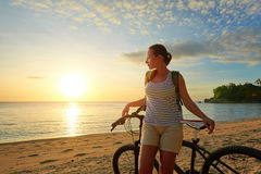 Traveler girl with backpack enjoying view of beautiful  island a Stock Images