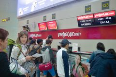 Traveler girl  at Can-tho Airport. Check in Vietjet December 2016 - Vietnam Stock Images