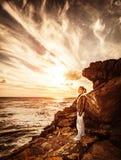 Traveler girl on the cliff Stock Photos