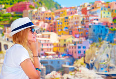 Traveler girl enjoying colorful cityscape Royalty Free Stock Photography