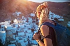 Traveler girl enjoying mountainous village view royalty free stock photo