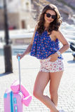 Traveler girl going to vacations with pink suitcase Royalty Free Stock Images