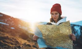 Traveler girl hold in hans map and look sun flare, people planning trip, hipster tourist on background nature, enjoy journey land stock photos