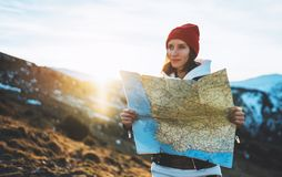 Traveler girl look and hold in hands map, people planning trip, hipster tourist on background sun flare nature, enjoy journey. Landscape vacation trip stock images