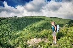 Traveler girl in the mountains Stock Photo