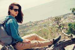 Traveler girl resting on tree Stock Image