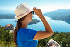 Traveler girl searching right direction, freedom and active life Stock Image
