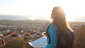 Traveler girl searching right direction on map stock video