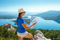 Traveler girl searching right direction on map,  freedom and act Royalty Free Stock Image
