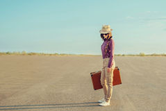 Traveler girl standing on road in summer Royalty Free Stock Photo