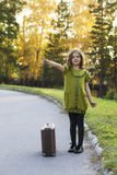 Traveler girl with a suitcase Stock Image