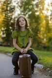 Traveler girl with a suitcase stock photography