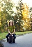 Traveler girl with a suitcase Stock Photos