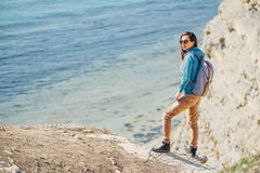 Traveler girl walking on coast in summer Royalty Free Stock Images