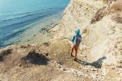 Traveler girl walking on coastline in summer Royalty Free Stock Images