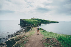 Traveler girl walking on island in summer Royalty Free Stock Photography