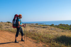 Traveler goes on the road along Mediterranean coast Royalty Free Stock Photography