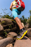 Traveler going uphill on the rocks Stock Photos