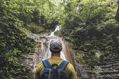 Free Traveler Has Reached Destination And Enjoying View Of Waterfall And Beauty The Unspoilt Nature. Contemplation Adventure Concept Royalty Free Stock Image - 95065236