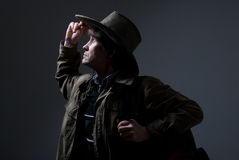 A traveler in a hat looking to the side and the top Royalty Free Stock Photography