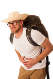 Traveler having stomach ache, nausea wearing straw hat, white sh. Irt and backpack. Isolated over white Stock Images