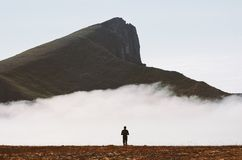 Traveler hiking alone in cloudy mountains travel adventure stock images