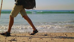 Traveler with Hiking Backpack goes Along the Coast stock video