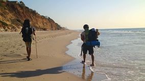 Traveler with Hiking Backpack goes Along the Coast.  stock video footage