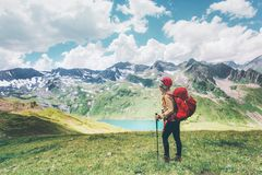 Traveler hiking in mountains enjoying lake view Travel Lifestyle adventure concept happy emotions summer vacations outdoor. Exploring wild nature royalty free stock image