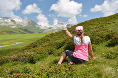 Traveler on the hill. Melchsee-Frutt, Switzerland Royalty Free Stock Photo