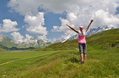 Traveler on the hill. Melchsee-Frutt, Switzerland Stock Photo