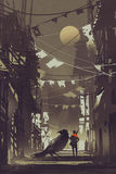 The traveler with his crow in abandoned city at night Stock Image