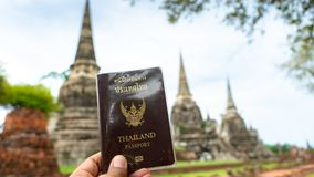 Traveler holding Thailand passport in Ayutthaya Thailand. Traveler holding Thailand passport in Ayutthaya Province Thailand royalty free stock image
