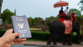 Traveler holding Thailand passport in Ayutthaya Thailand. Traveler holding Thailand passport in Ayutthaya Province Thailand stock images
