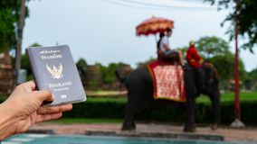 Traveler holding Thailand passport in Ayutthaya Thailand. Traveler holding Thailand passport in Ayutthaya Province Thailand royalty free stock photography