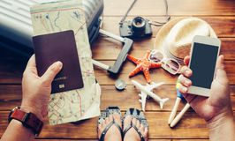Traveler holds passport and smart phone with luggage, costume,. Camera in the floor background. Along with travel royalty free stock photos