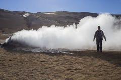Traveler at Hverarondor Hverir hot springs, Iceland Royalty Free Stock Photo