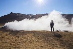Traveler at Hverarondor Hverir hot springs, Iceland Stock Images