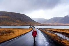 Traveler on Icelandic road in Snaefellsnes peninsula of Iceland. Traveler on scenic Icelandic road in Snaefellsnes peninsula of Iceland woman icelad female girl stock images