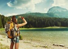 Traveler at the lake Stock Photo