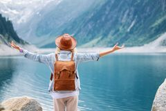 Traveler look at the mountain lake. Travel and active life concept. Adventure and travel in the mountains region in the Austria royalty free stock photo